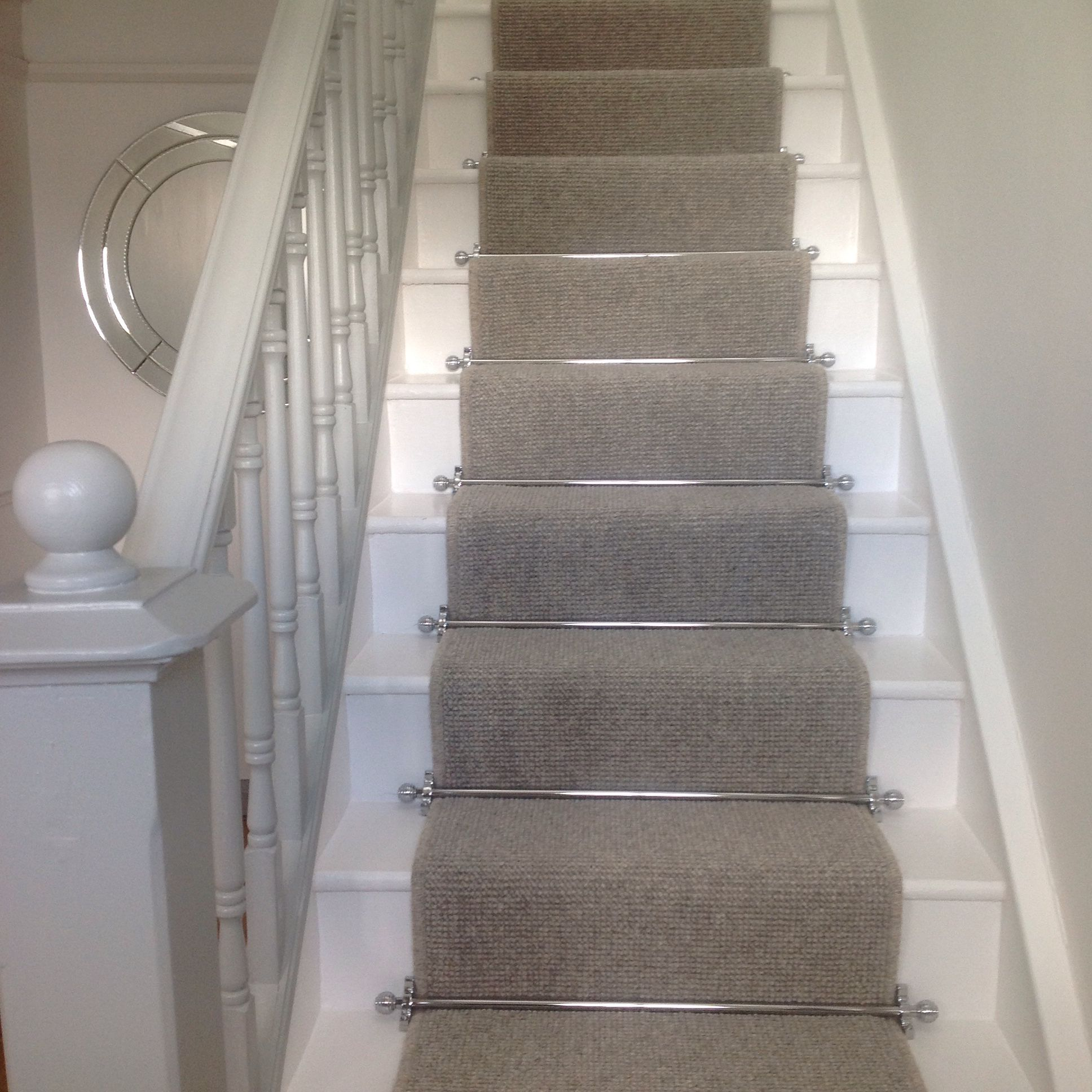 Runner On Stairs With Grey Carpet With Chrome Bars For