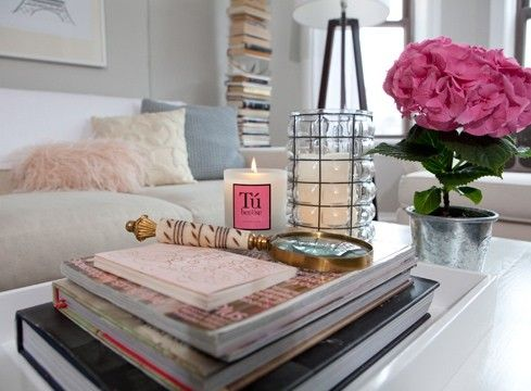 candles in different sizes + fresh flowers on coffee table
