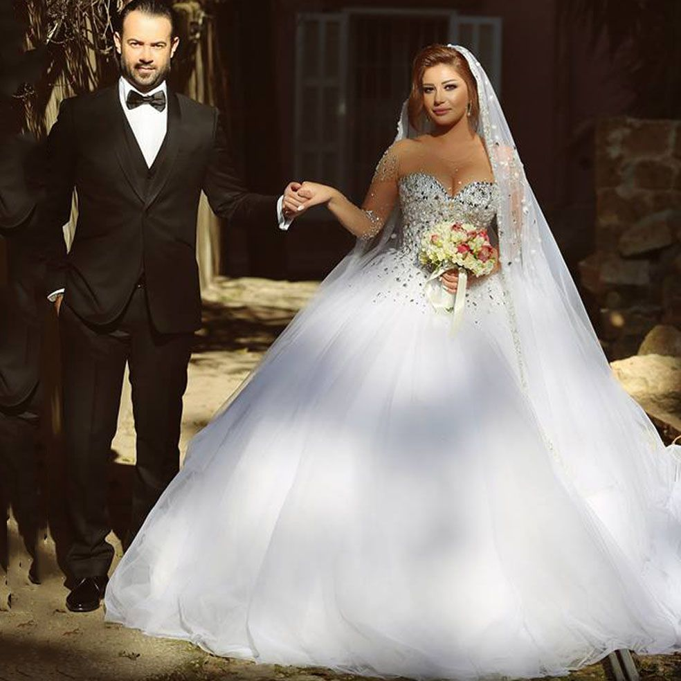 Ball gown wedding dress with sleeves  Click to Buy ucuc Said Arabian Design Illussion Jewel Beaded Bling