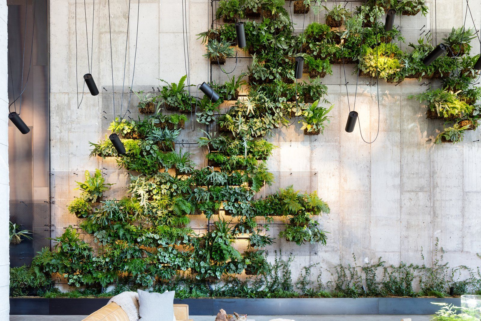 Vertical Living Wall Accentuating the lobby of the eco-conscious 1 Hotel Brooklyn Bridge is a  25-foot, vertical living wall that blends industrial motifs with natural  elements.