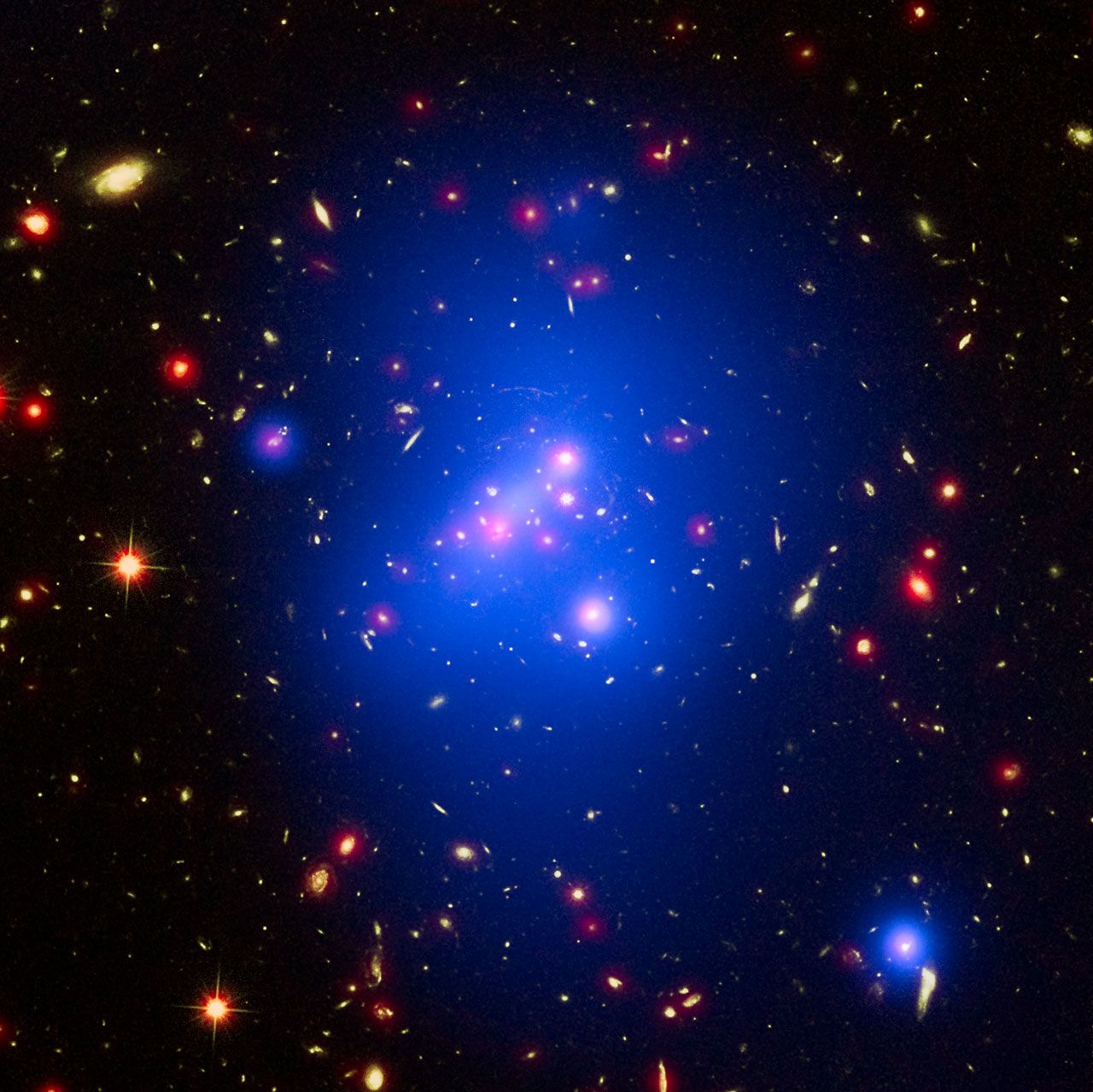 Galaxy cluster IDCS J1426Astronomers have made the most detailed study yet of an extremely massive young galaxy cluster using three space telescopes. This multi-wavelength image shows this galaxy cluster, called IDCS J1426.5+3508 (IDCS 1426 for short), in X-rays from the NASA Chandra X-ray Observatory in blue, visible light from the NASA/ESA Hubble Space Telescope in green, and infrared light from the NASA Spitzer Space Telescope in red.This rare galaxy cluster, which is located 10 billion…
