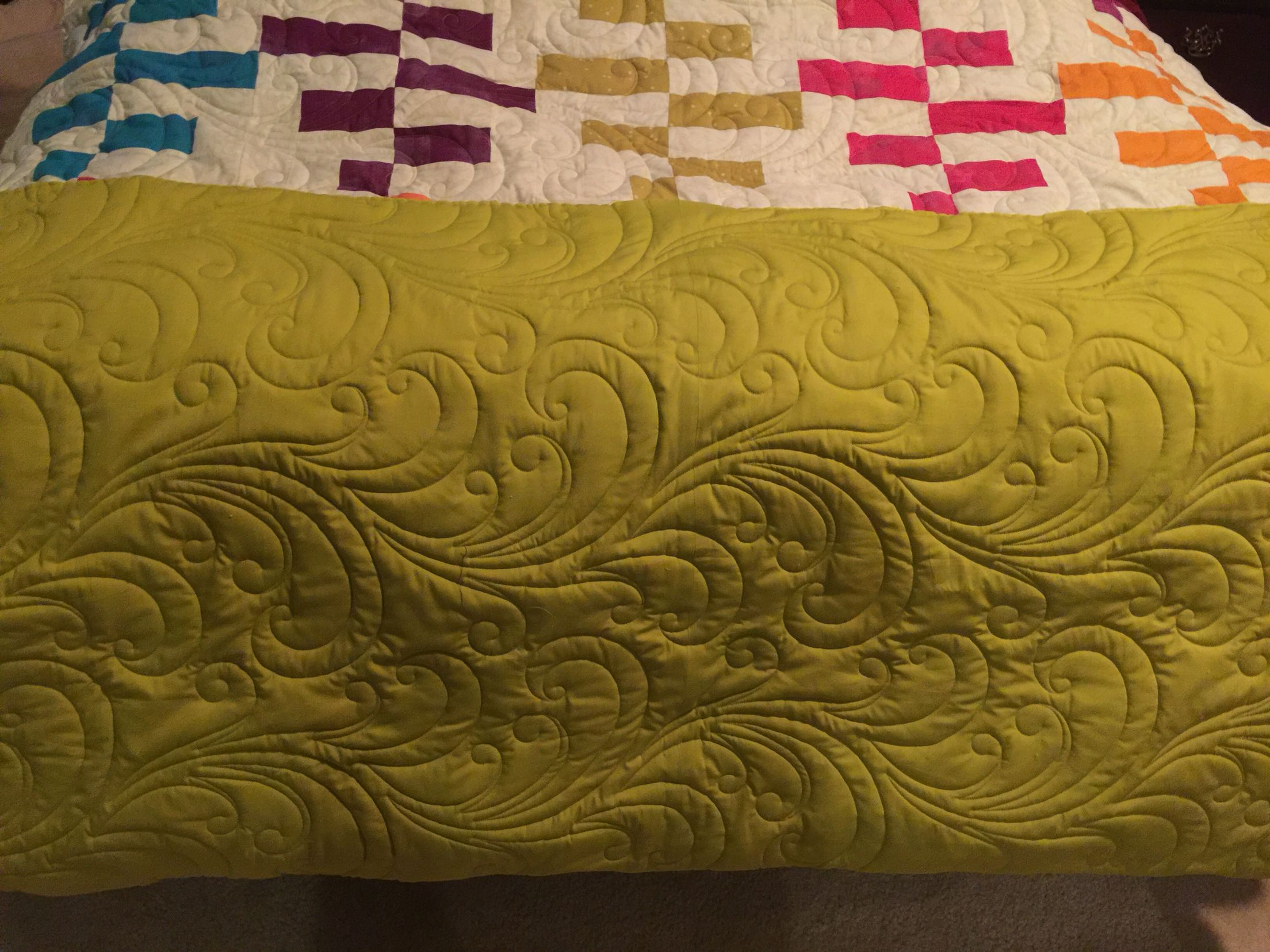 Here is the back of my Ripple Quilt.  The pattern is from GE Designs.  Fabric is mostly grunge with Hoffman batik on the back.  This is a double wool batting which shows the quilting so fabulously.  Created and longarmed by Kate Quinn of FabriKated Quilts