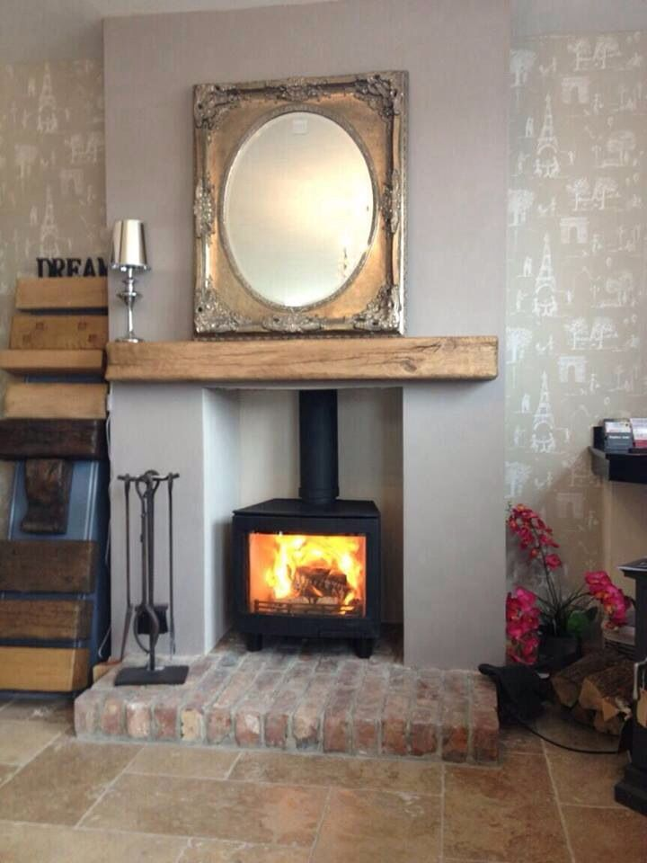 Wood burning stove with oak beam wood burning stoves and for Living room ideas with wood burning stoves