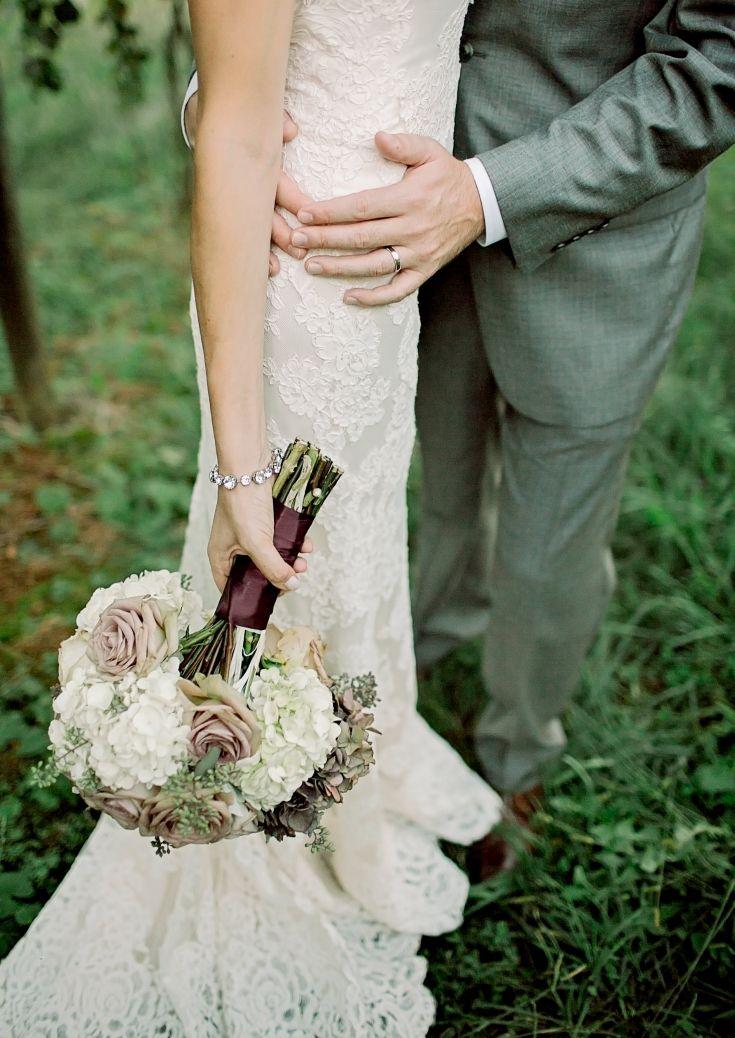 Liza & Luke | Married at Frogtown Cellars flowers, bridal love pose