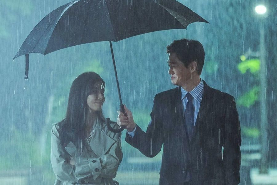 """Lee Bo Young And Yoo Ji Tae Share Smiles In The Rain In """"When My Love Blooms"""""""