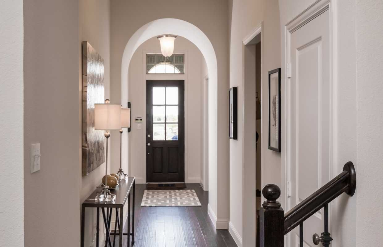 Front Entry of 1602 Emerald Bay Lane Highland Homes Model Home at Inspiration in St. Paul, Texas