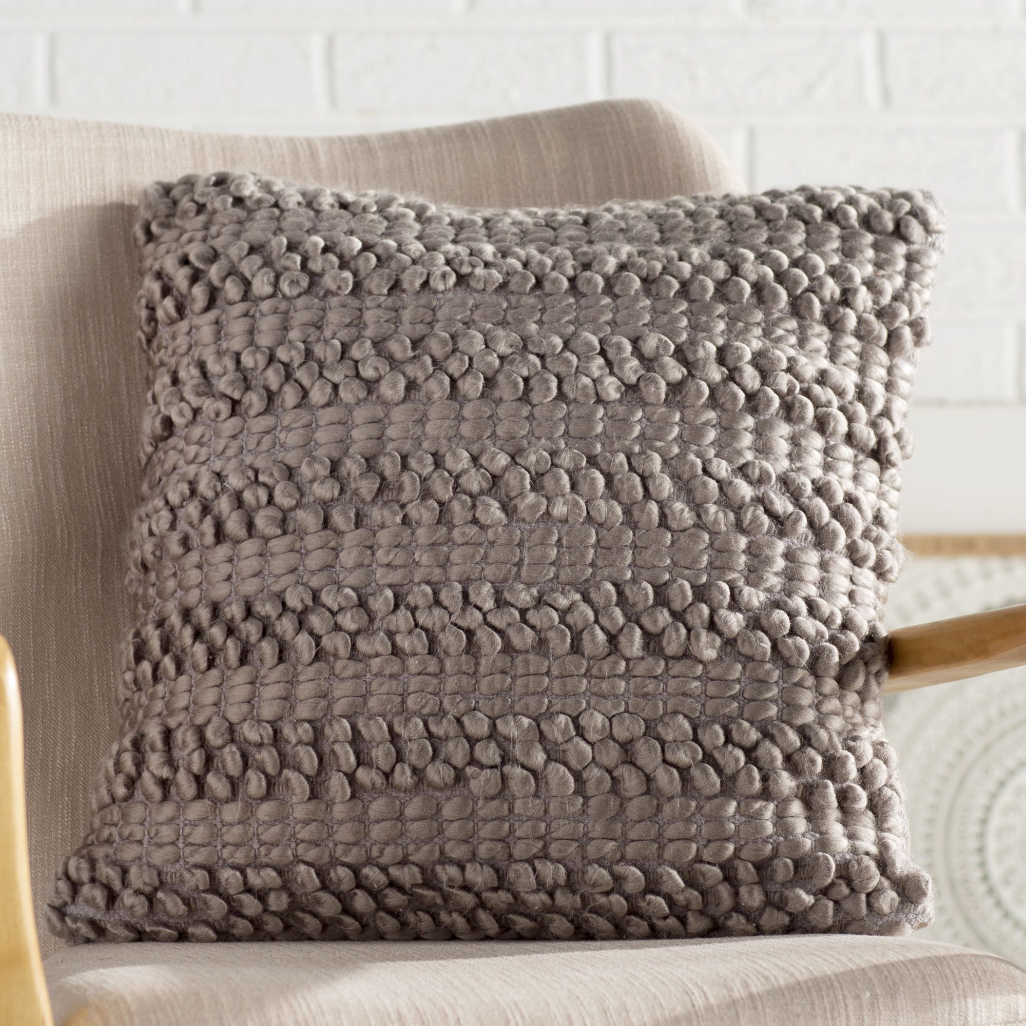 in wool boucle puff throw image alternative with woven cream delicate puffs hand pillow pillows