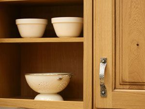 Need an easy cabinet makeover? Without even repainting or replacing the doors, you can use knobs and pulls to lift your old cabinetry out of the doldrums.