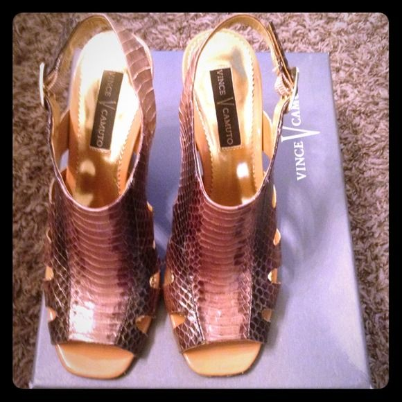 FINALVince Camuto Snake Peep Toe Heels 6.5 Glossy, shiny bronze/brown. There are areas where its kinda peeling on the bottom- nothing major. Only worn a handful of times. Vince Camuto Shoes Heels