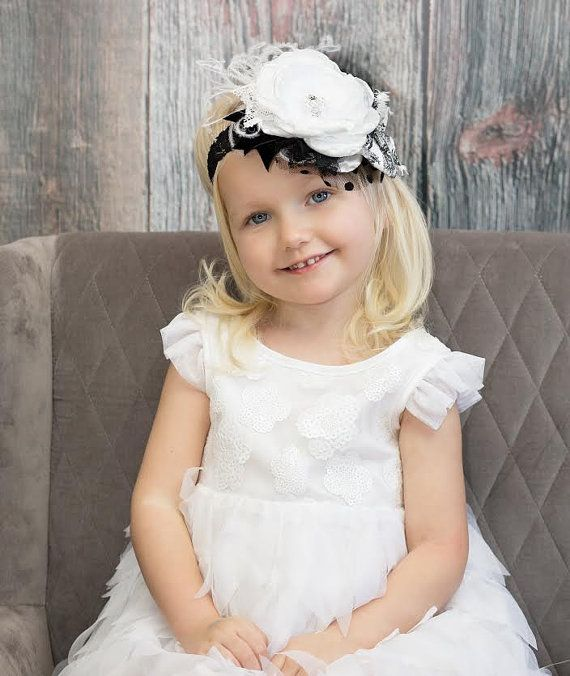 Firma Le Petite Jardin flor blanco y negro la por lepetitejardin