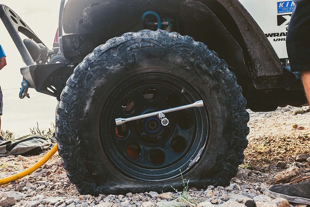 How To Change A Flat Tire After A Blowout When Everything Goes