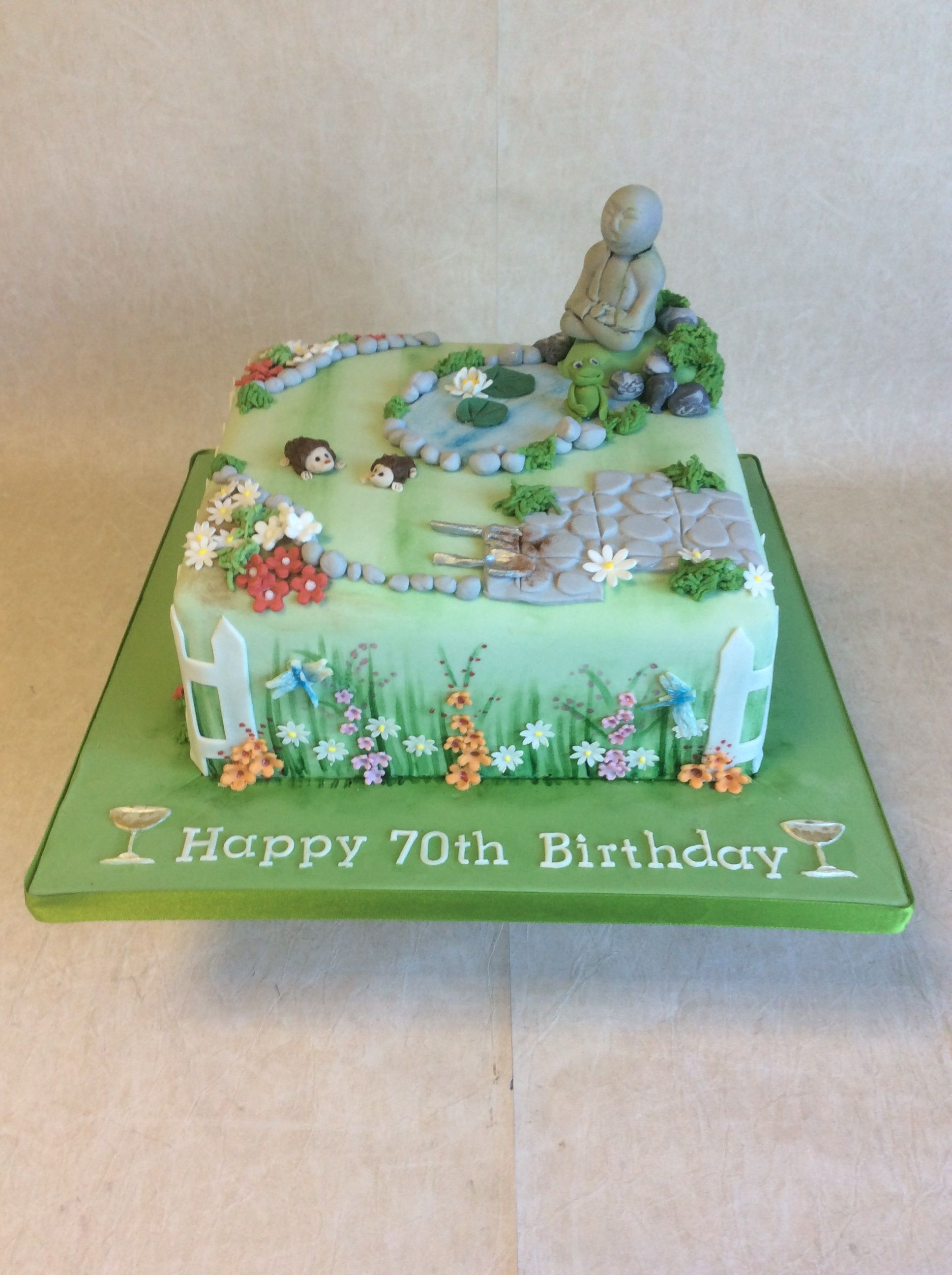 Garden themed cake including dragonflies, hedgehogs, a frog and a ...