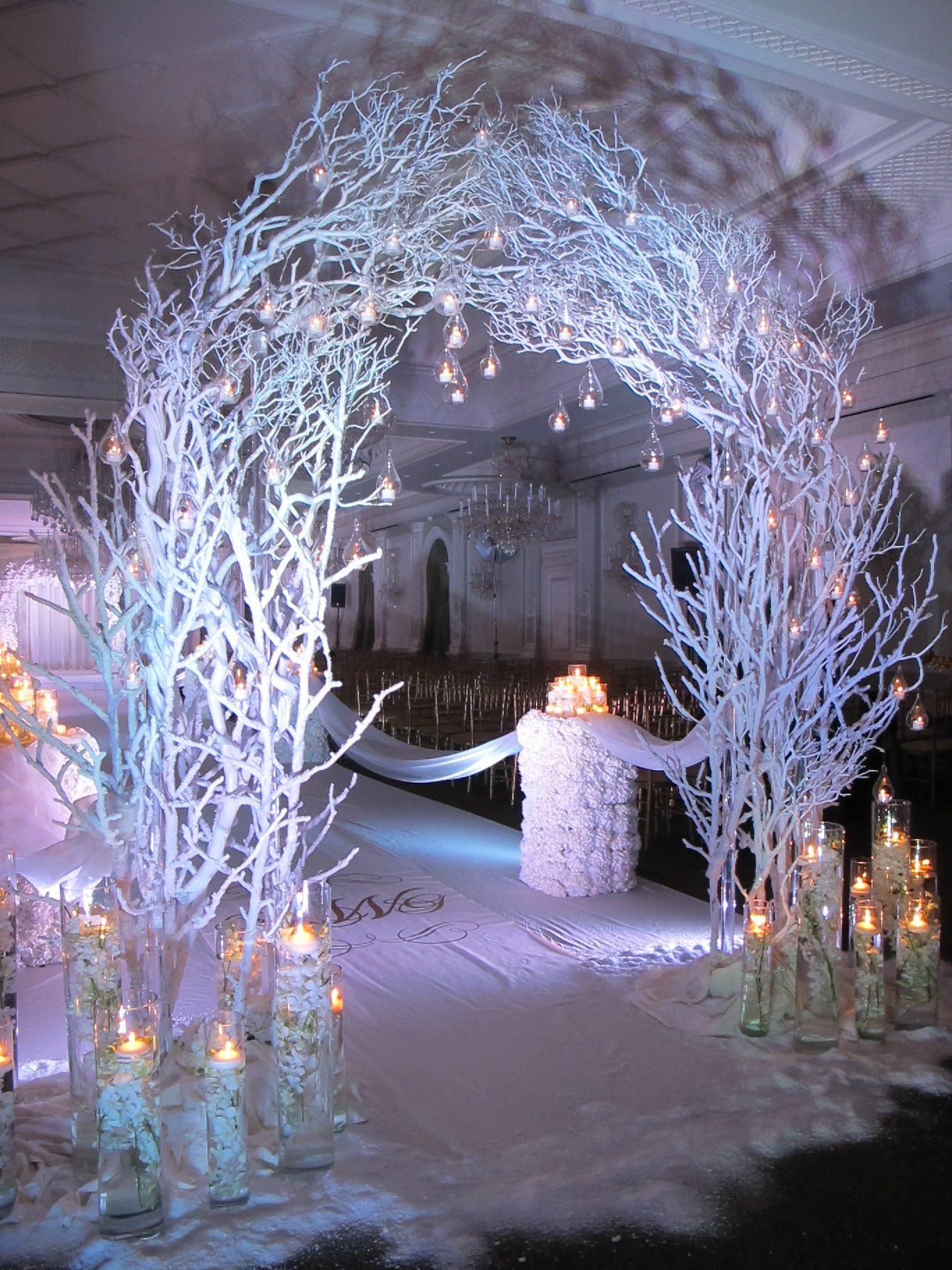 stunning winter themed ceremony arch w candle accents. Black Bedroom Furniture Sets. Home Design Ideas