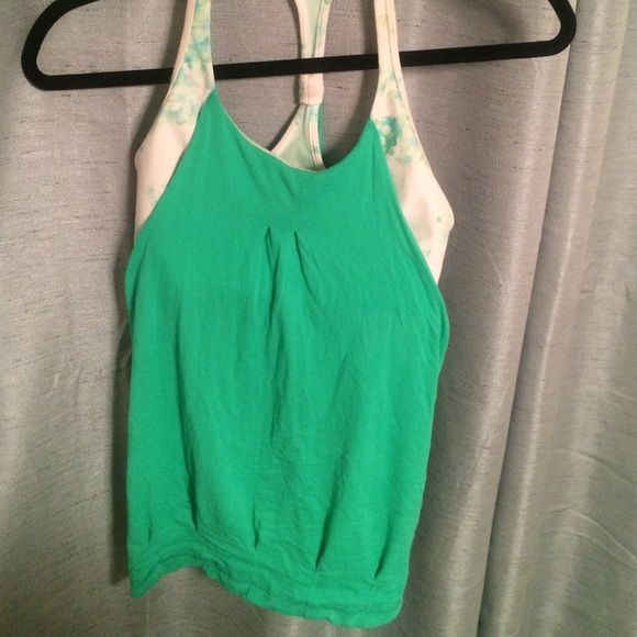 Lulu lemon tank Like new condition. Built in sports bra. Padding not included. Price negotiable. Size four but runs small lululemon athletica Tops Tank Tops
