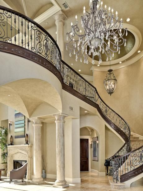 2 Story Entry Way. Rod Iron Railing. Spiral Staircase. Chandelier. Breath  Taking.