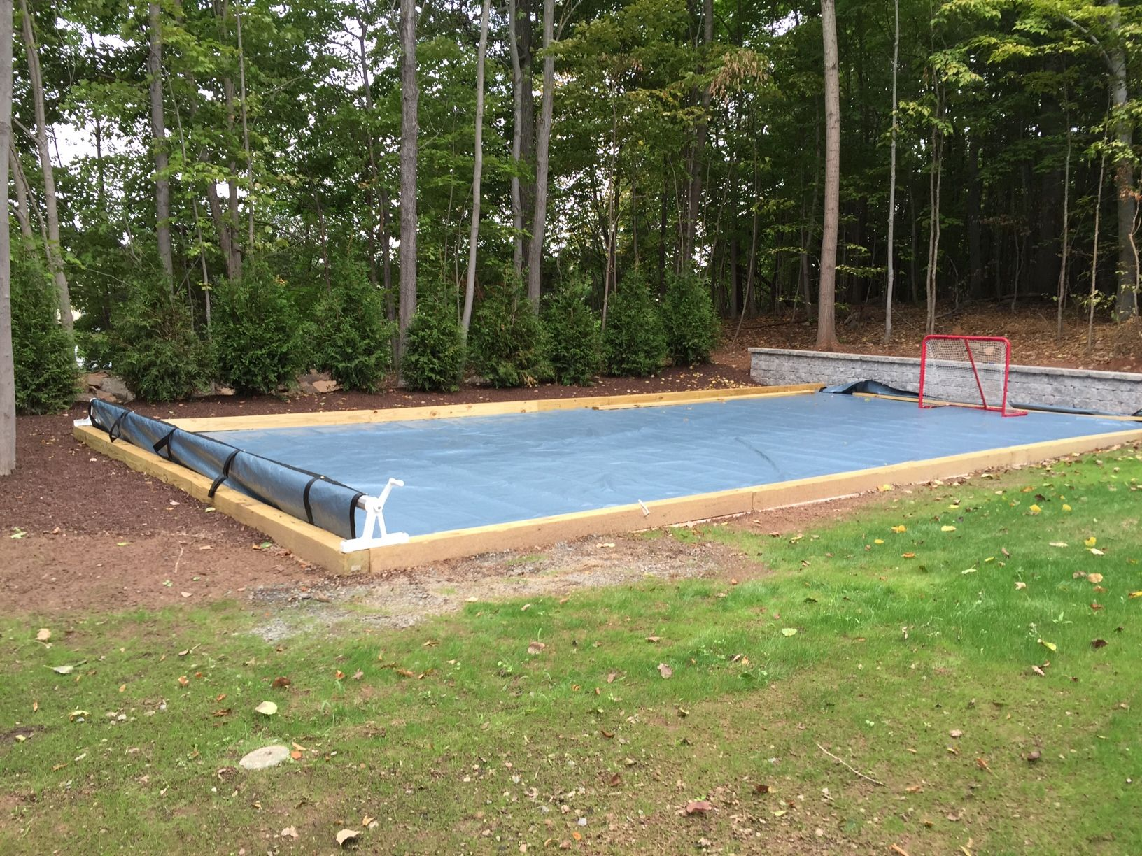 creative use of a pool cover to keep the synthetic ice surface