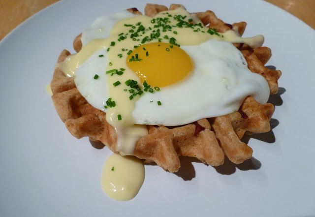 Photo of Roux-Tasso Waffle Topped with Egg and Cheese
