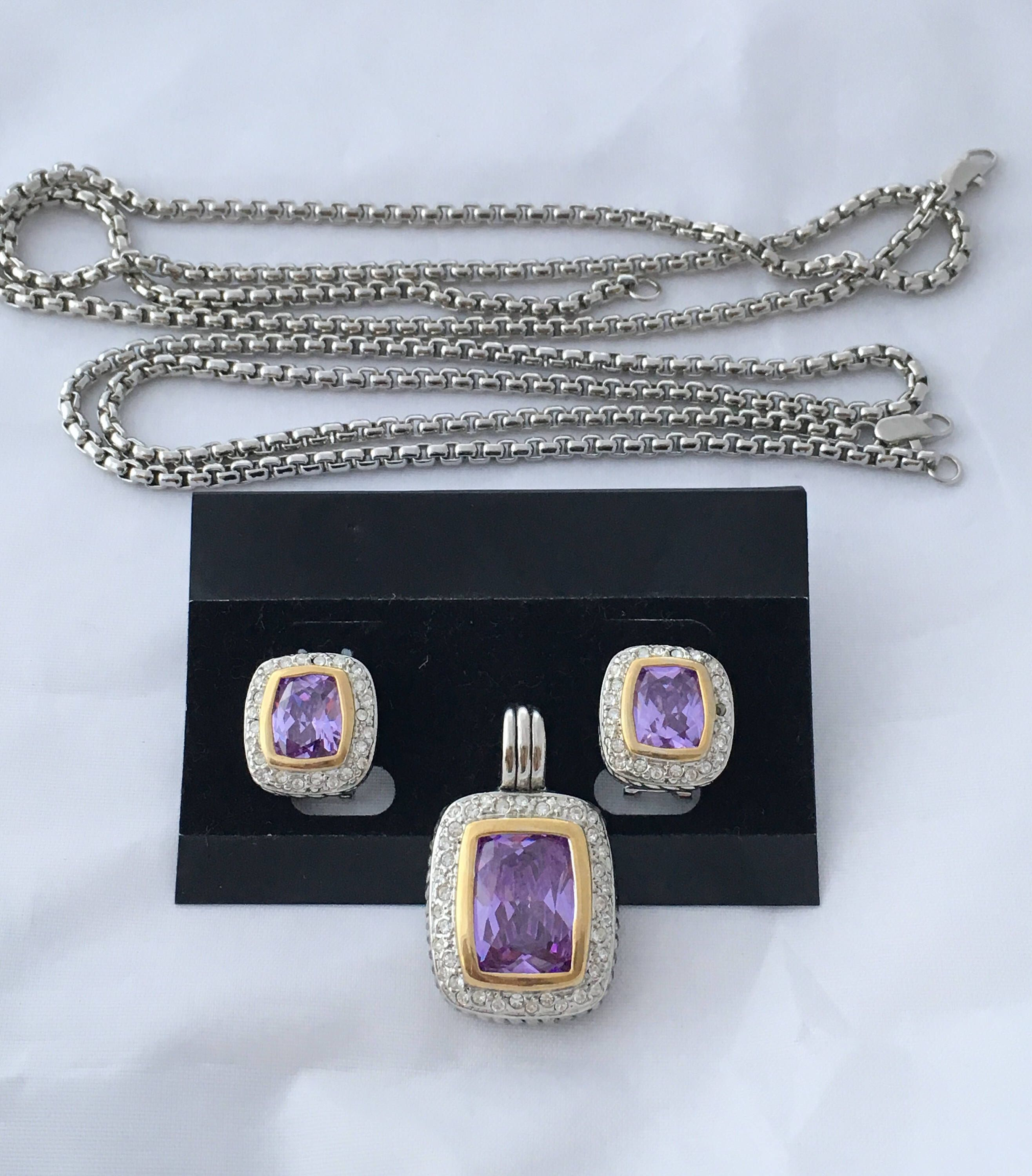 42c3ecf88 Elegant Faceted Faux Central Topaz Rhinestones Set With Two Silver ...
