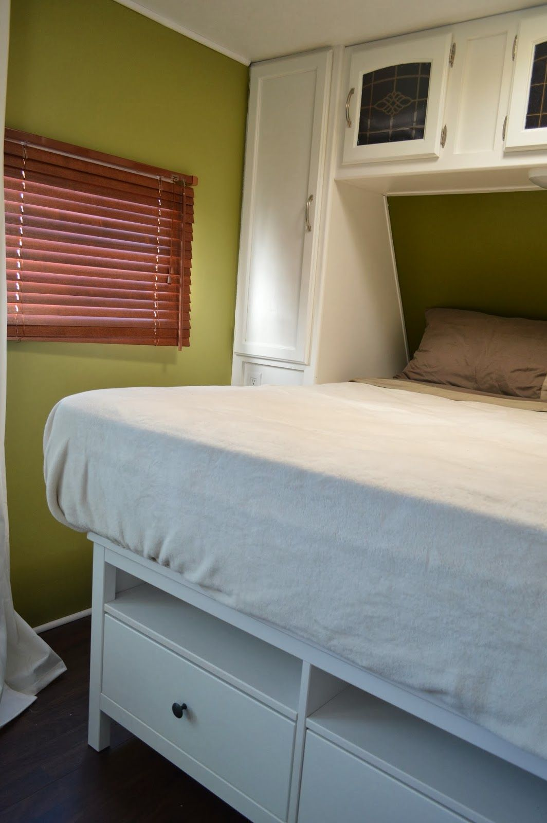 Use small console table for the foot of the bed. Adds