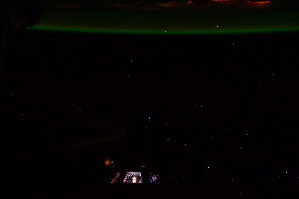 Warm glow of city lights and earths atmosphere. Look closely and you can see me in the cupola.