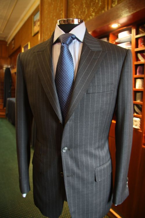 Pure wool Charcoal grey Pin Stripe by Holland & Sherry Single breasted 3 button with peak lapels….Different but turned out well