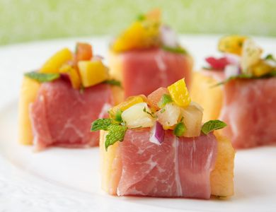 Flavor-Topped Fruit Cubes  For a balance of fresh flavors, start with a sweet base of cubed cantaloupe wrapped in salty prosciutto. Once topped with our Simple Southwest Fruit Salsa, garnish your newest crowd pleaser with mint.