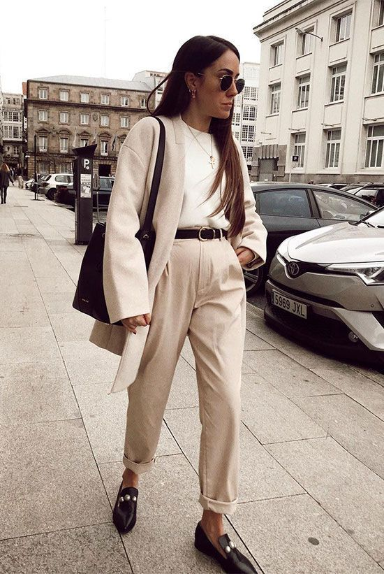 Trendy wearing a beige cardigan, a white shirt, beige high waist trousers, a black belt, black embellished loafers, a black bucket bag and round aviator sunglasses. Workwear, workwear women, spring work outfits, spring work outfits 2019, officewear, business casual, wear to work, work styles, spring outfits, spring style, #weartokork #officewear #businesscasual #workwear #workoutfits #9to5chic #springstyle #springfashion2019 #fashion2019 #ootd #streetstyle