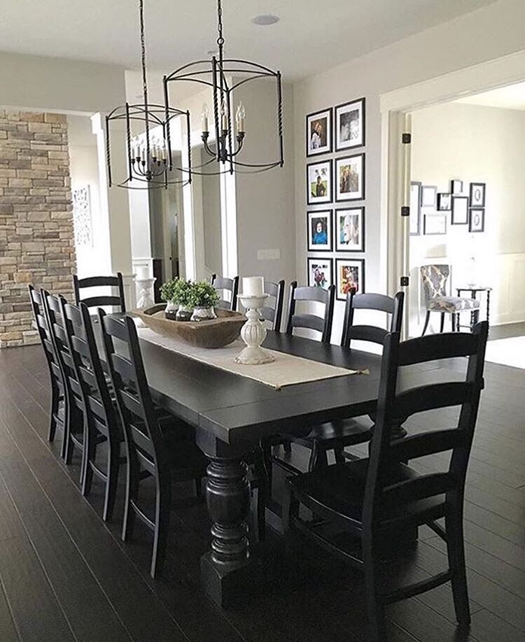 Modern farmhouse dining table with oversized lantern chandeliers and floor to ceiling gallery wall