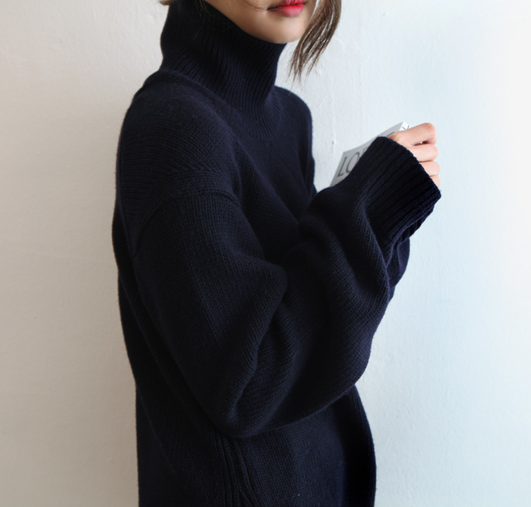 chunky/oversized/baggy black sweater turtleneck. It's, like, THE ...