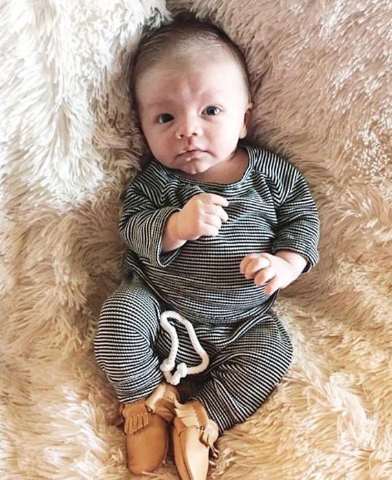 Photo of Gender neutral baby outfit, black and white stripes, baby boy clothes, thermal baby clothes.