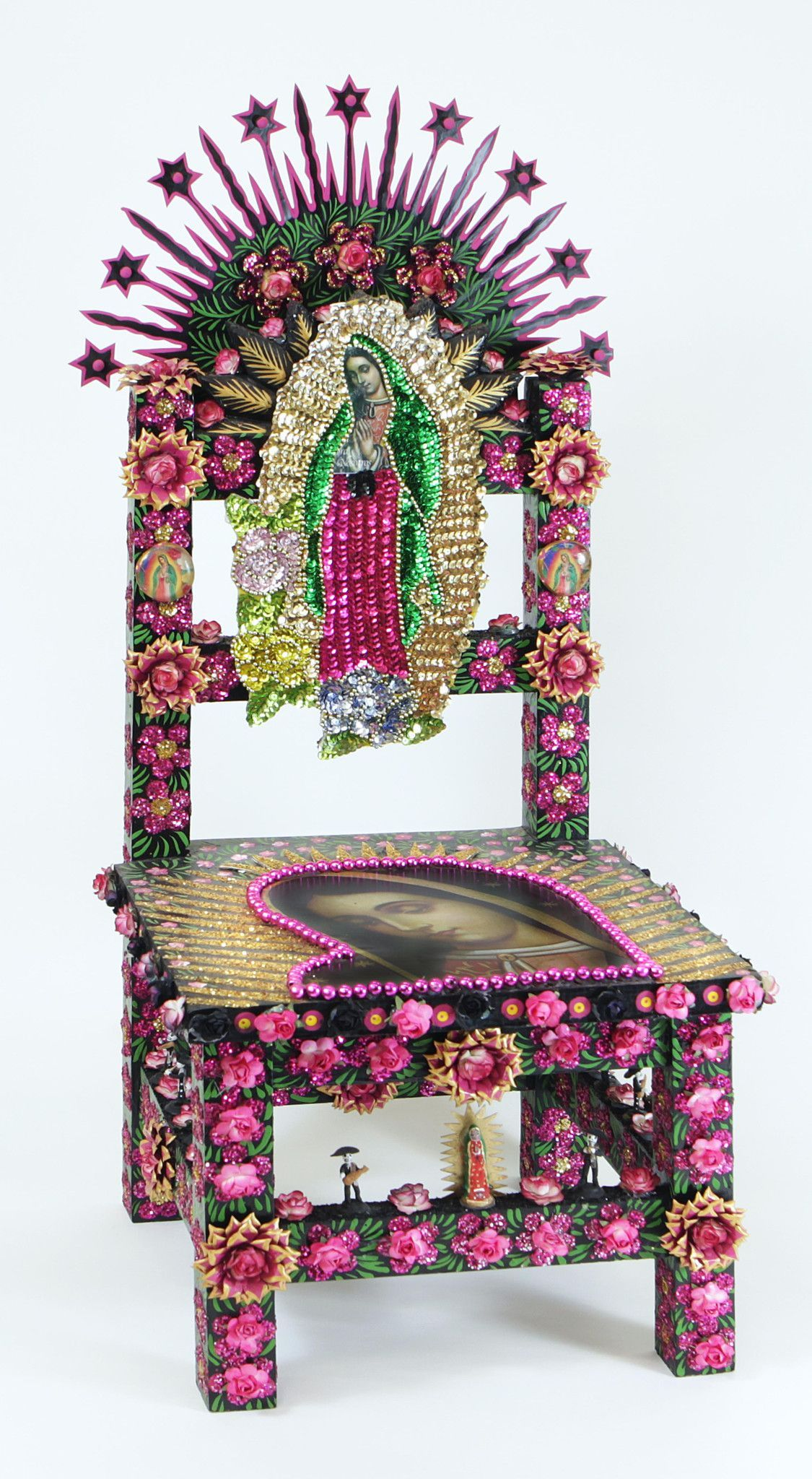 This vibrant and imaginatively decorative chair featuring the Virgin of Guadalupe was handpainted and decorated by local artisans in San Miguel de Allende, Mexico. A wire is assembled on the back enab