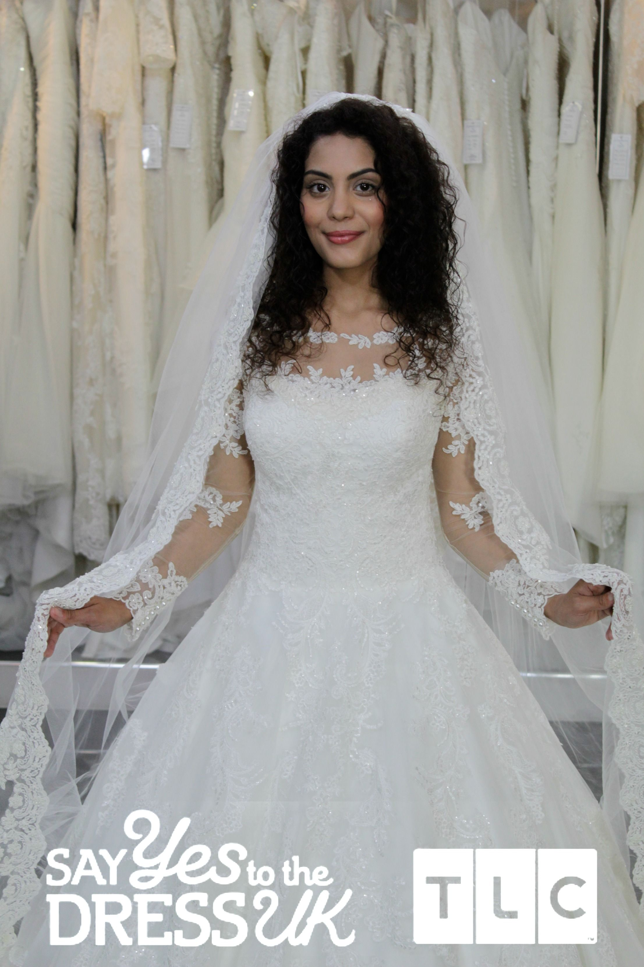Long lace sleeves and dramatic detailing on this veil make