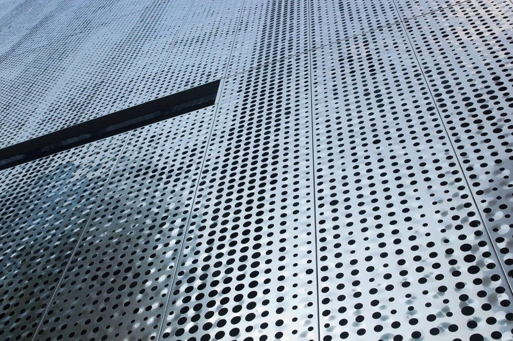 Perforated metal sheet panels make for interesting building facades ...