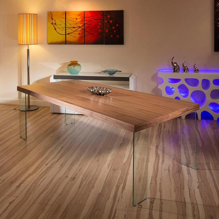 Massive rectangular modern walnut dining/boardroom table glass leg. Special features include strong thick tempered glass legs. Beautifully crafted and will comfortably seat up to 12. Many chairs available separately - please call or email for details. The table has steel reinforcement to keep it straight and true. Call 02476 642139 or email sales@quatropi.com for additional information.