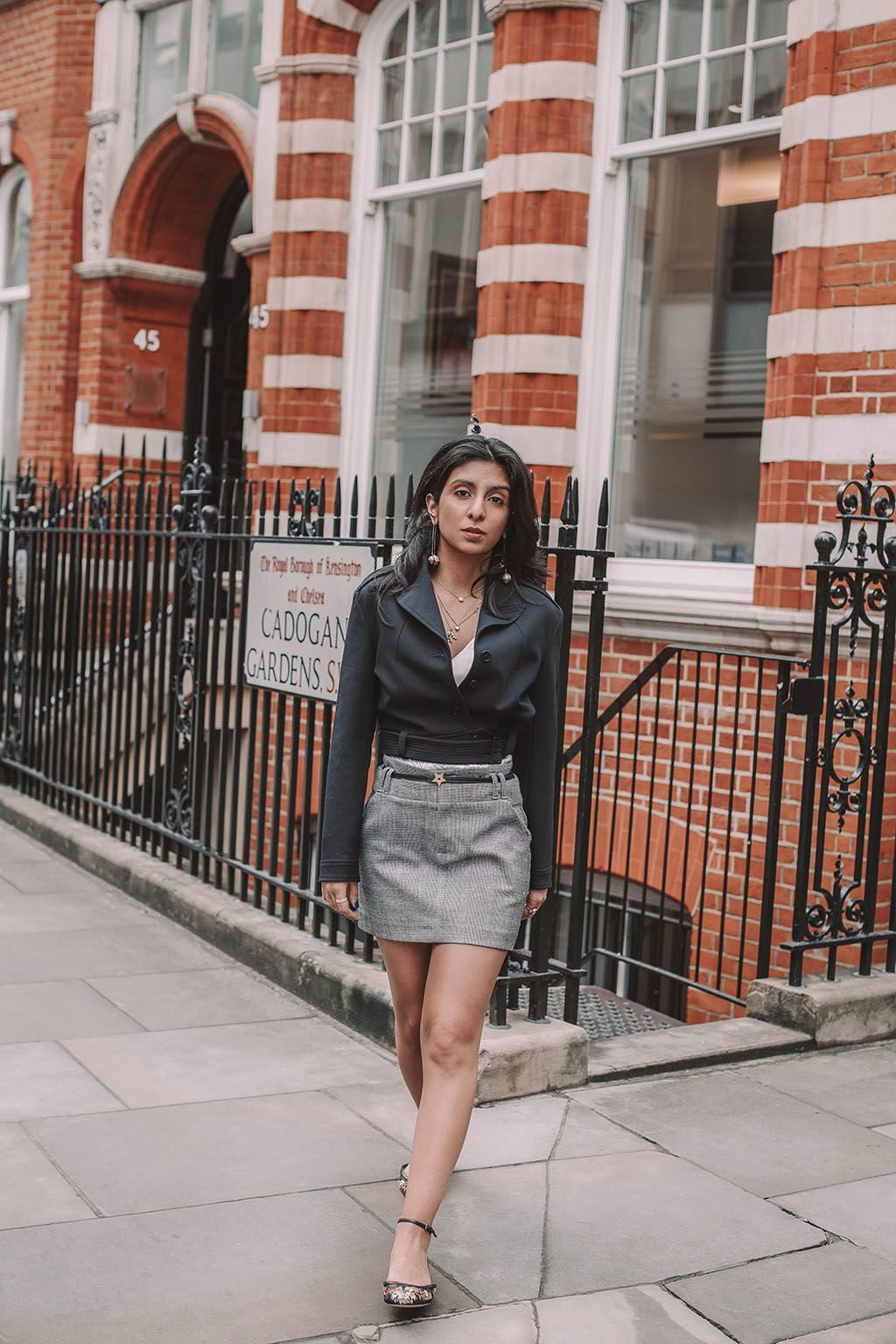 3e1e89b87 Fashion blogger Shloka Narang of The Silk Sneaker shares how to style a  plaid skirt to create the perfect summer outfit featuring Maje, Zara and  Dior