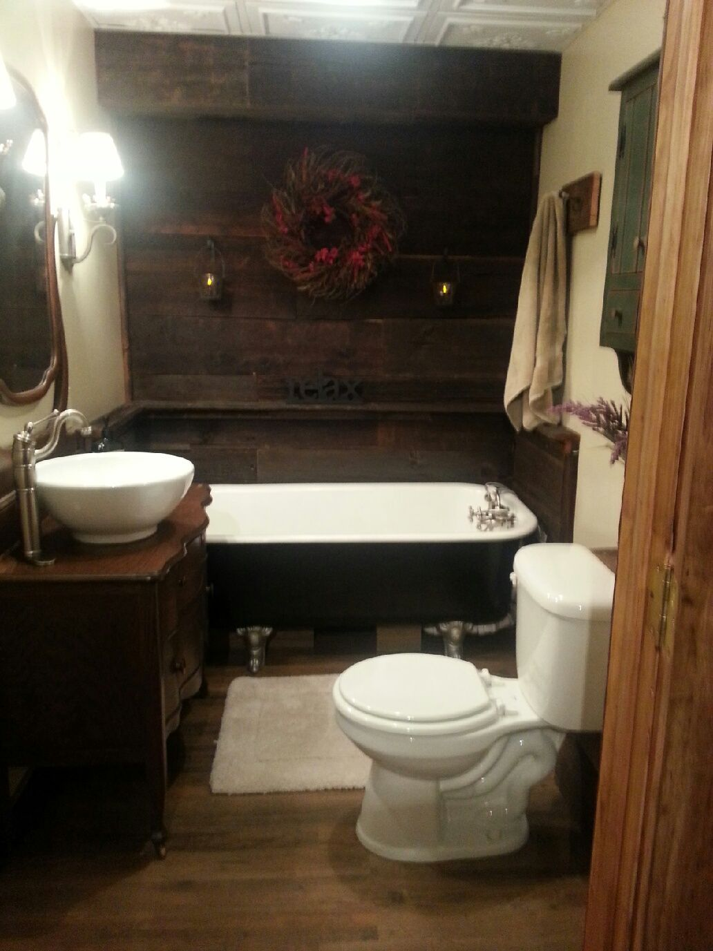 Rustic Bathroom with Antique Clawfoot tub and dresser ...
