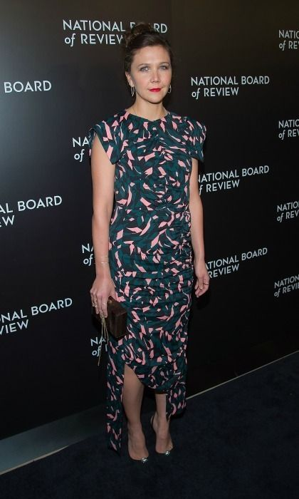 January 4: Maggie Gyllenhaal made a statement wearing a printed dress that featured an asymmetrical hem to the National Board of Review Gala in Manhattan. <br><p>Photo: © Getty Images