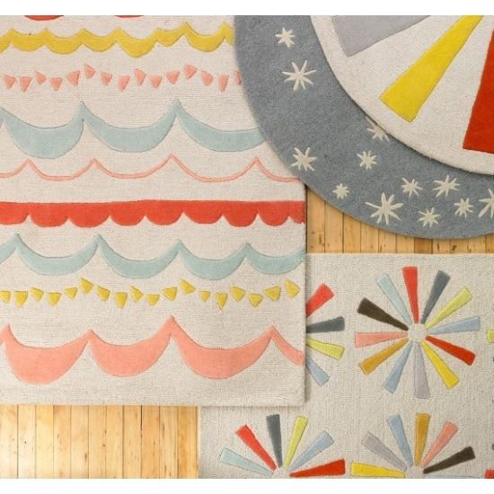 These DwellStudio rugs would look great in a child's room of any age, and just as cool in a living room or dining room.  They almost remind me of Thomas Paul, whose Swirl Rug is something I will always covet.
