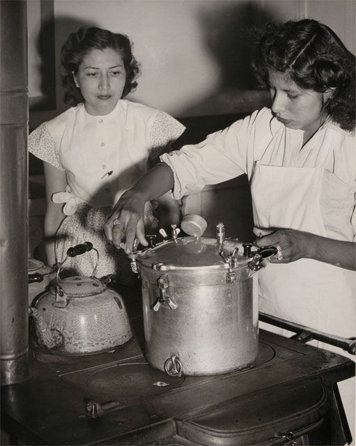 """Pueblo Girls Learning to Use Pressure Cooker, 1930s,"" by Frances E. and Henry Prior Clark. Braun Research Library Collection, Autry National Center from Mabel Dodge Luhan and the Remarkable Women of Taos: Mabel and Fabiola Cabeza de Baca: Home Making in New Mexico"