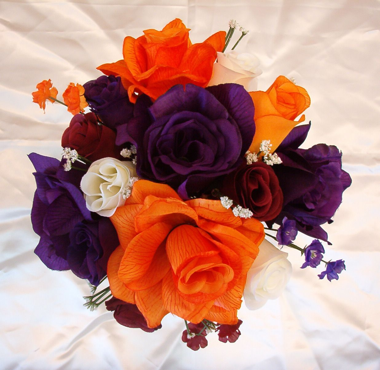 Wedding Flowers Cascading In White Plum And Orange Tl17