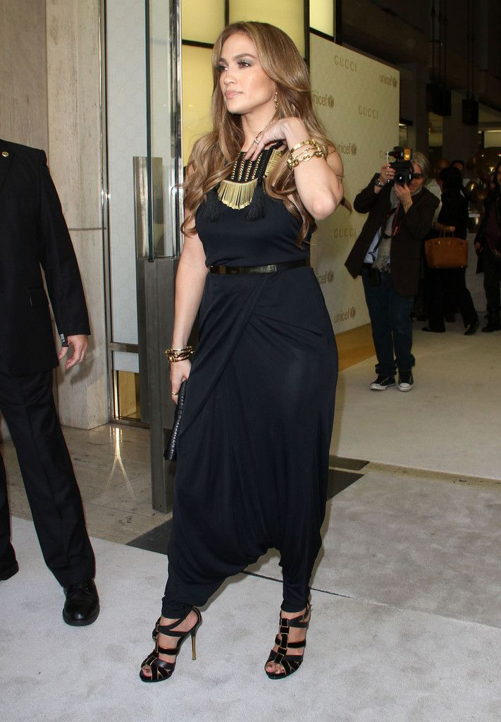 05de3fa9c79 Jennifer Lopez Jumpsuit - Jennifer wears a Gucci harem style jumpsuit for  the Children s Collection Launch. She paired this look with gold jewelry  and ...