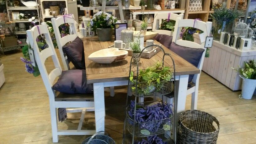 Distressed white and wood with purple cushions