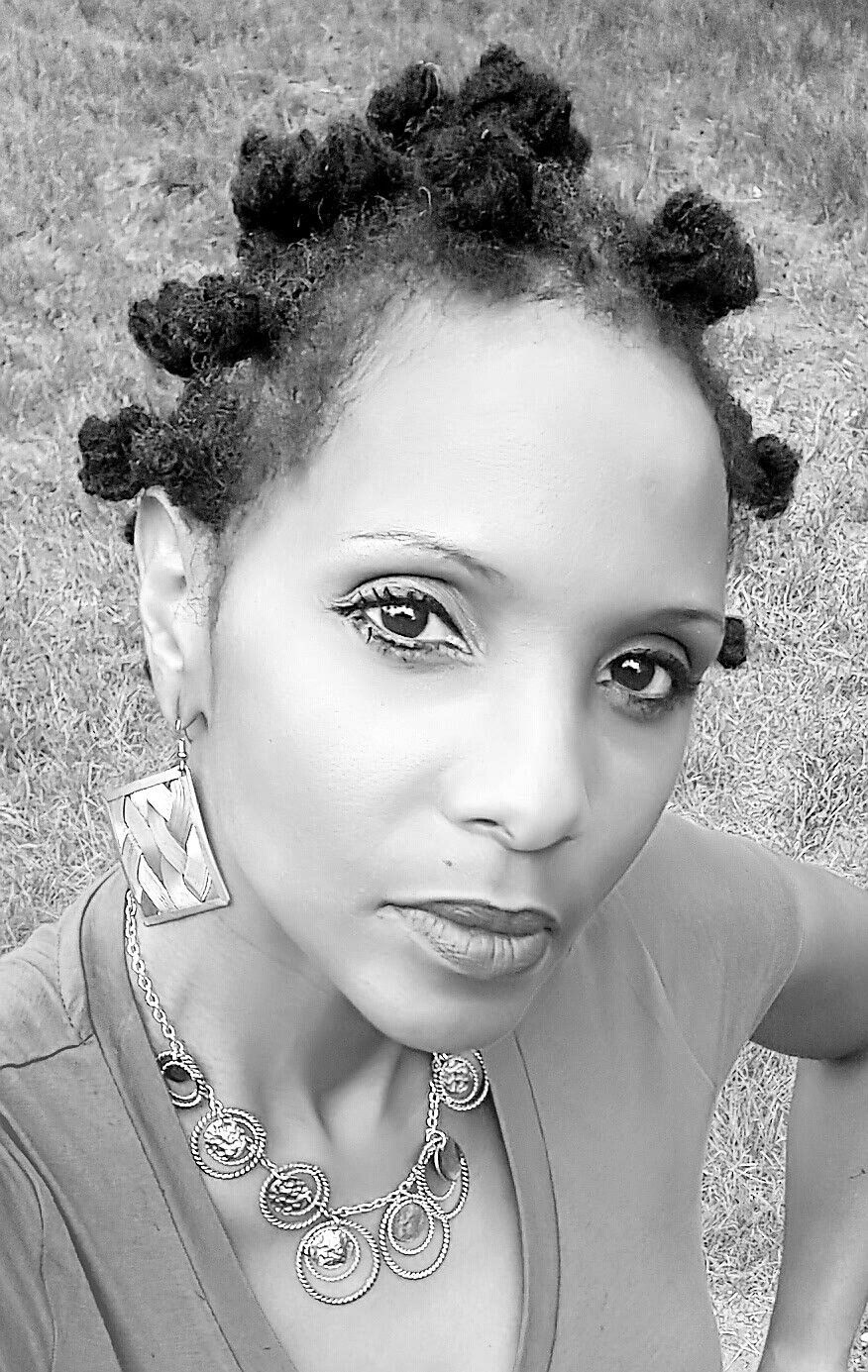 Embracing my gray and coily mane wearing a bantu knot hairstyle