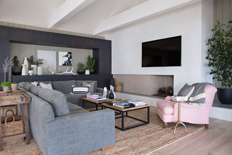 In This Contemporary Living Room, Dark Cabinetry Along One Wall Creates  Plenty Of Storage As
