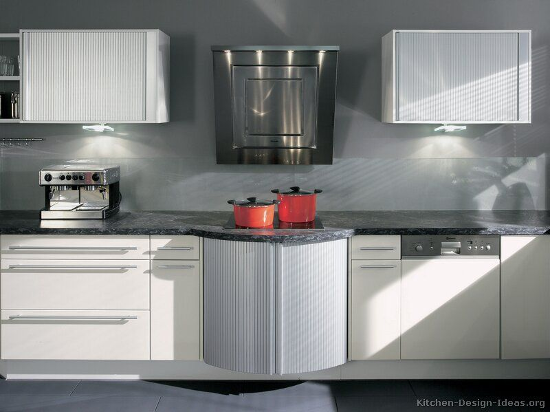 a contemporary white kitchen  manufactured by alno ag  with aluminum tambour door cabinets a contemporary white kitchen  manufactured by alno ag  with      rh   pinterest com