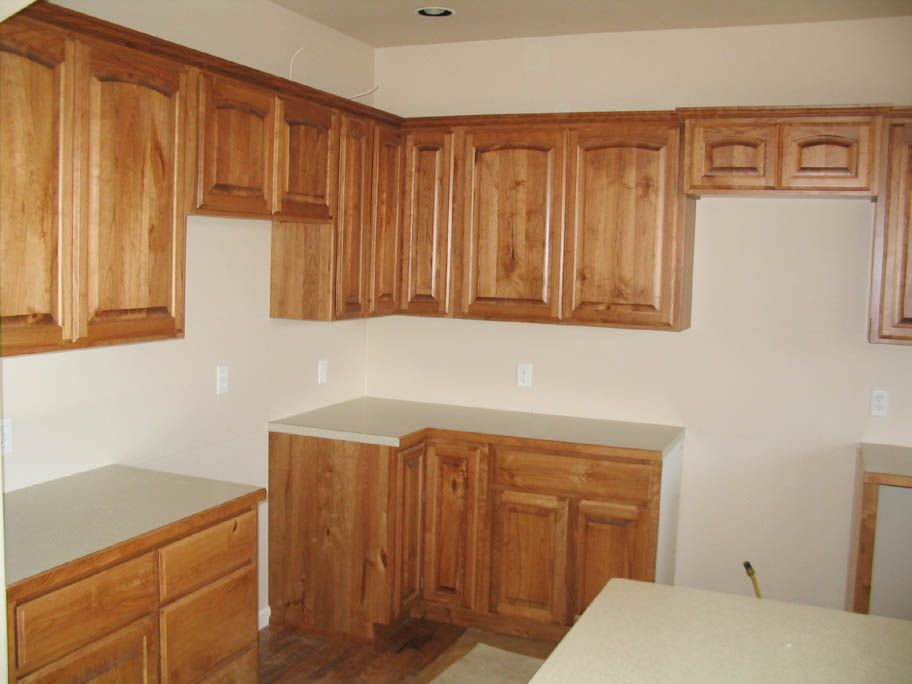colors of stains for cabinets | Rustic cherry cabinets in light ...