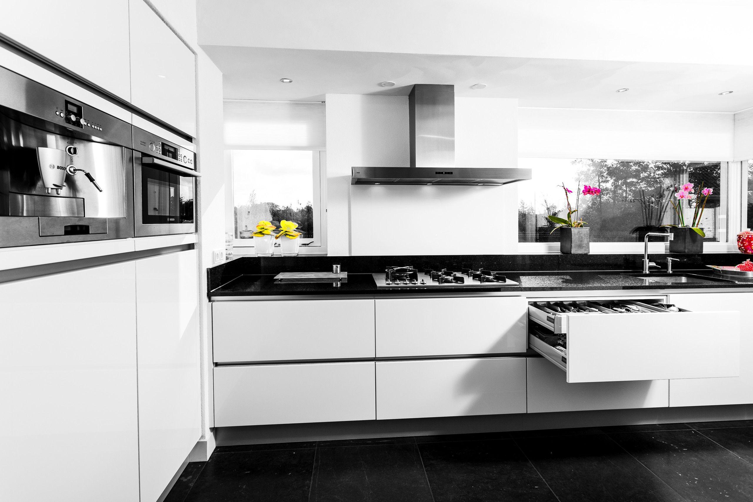 Welke kleur vloer bij hoogglans witte keuken keuken in