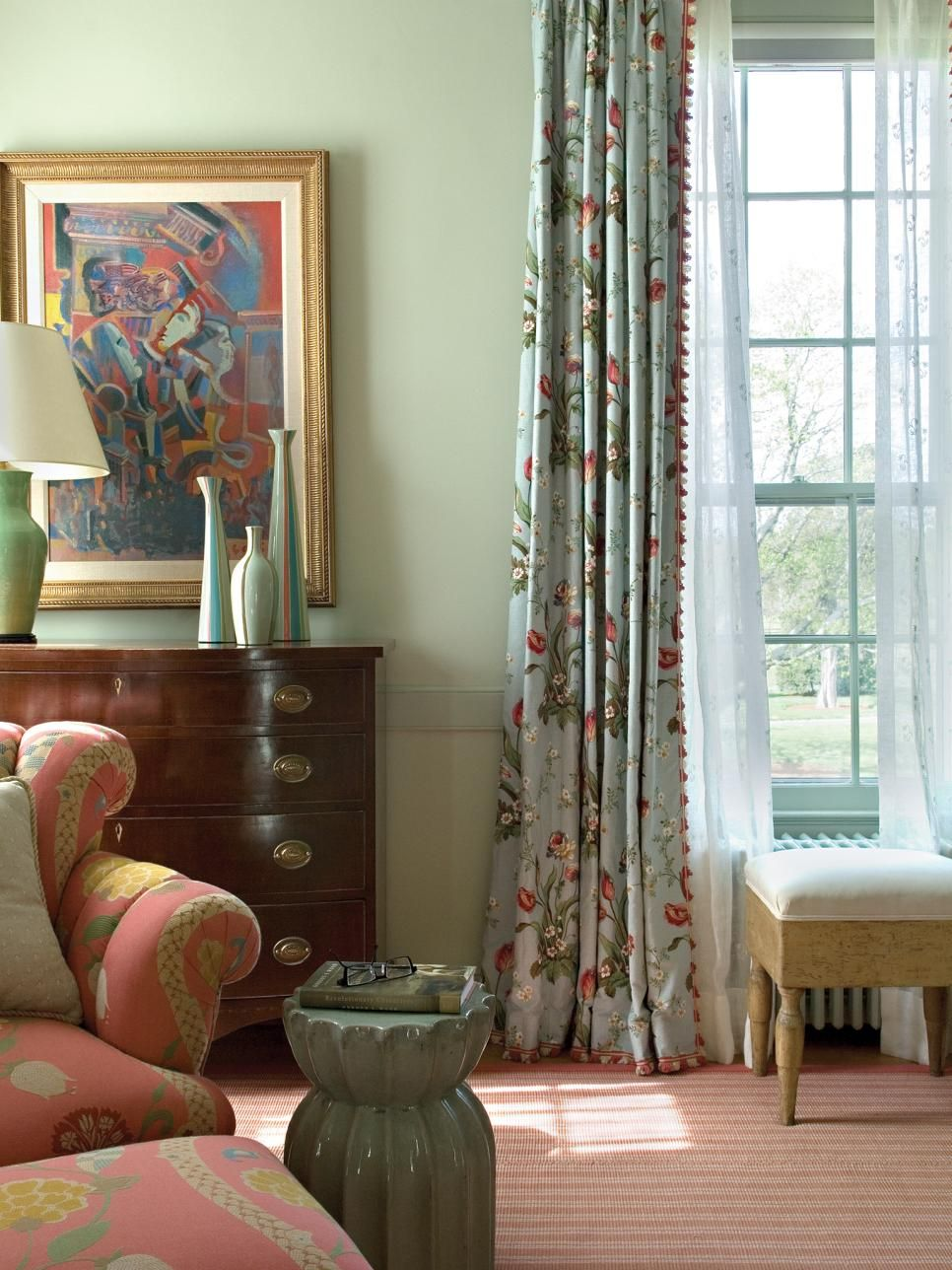 Blue and green floral curtains - Blue Floral Curtains With A Red And Green Floral Design Complement The Upholstered Armchair And Ottoman