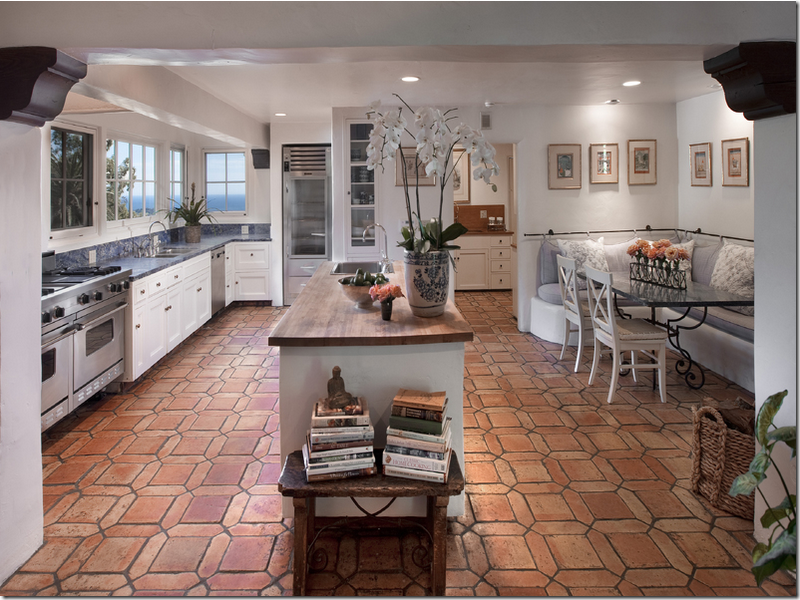 White cabinets, gray and wood counters, and terracotta floors ...
