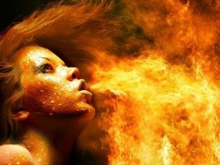 Woman blowing fire